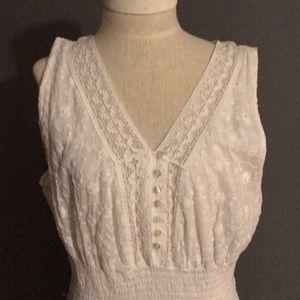 White sleeveless eyelet and cotton dress